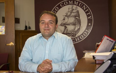 Argo Community High School Principal, Dr. Covino, at his desk.