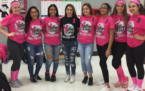 The Girls Volleyball Teams show off their support for breast cancer awareness.