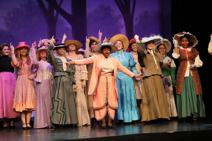 The cast during the number