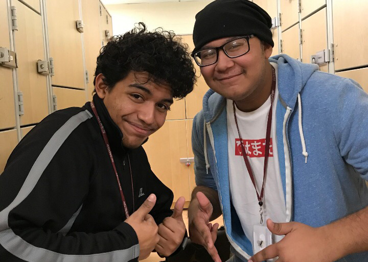 Alex Vega and Christian Bahena pose for quick photo before band rehearsal.